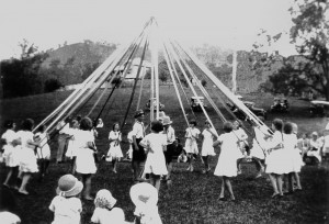 StateLibQld_2_102521_Children_doing_maypole_dancing_in_the_Canungra_Showgrounds_ca._1934